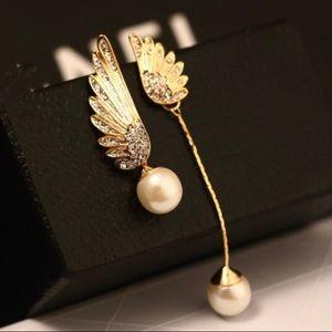 Gold tone pearl earrings